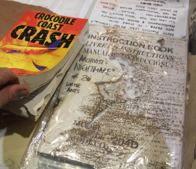 Archivist's Nightmare - Crocodile Coast Crash book by HL Young & sewing machine book eaten by Mastotermes whiteants in Kununurra